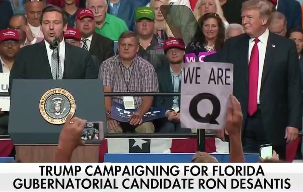 Unhinged conservative conspiracy theory goes mainstream at Trump's Tampa rally